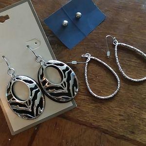 Three pairs of silver earrings